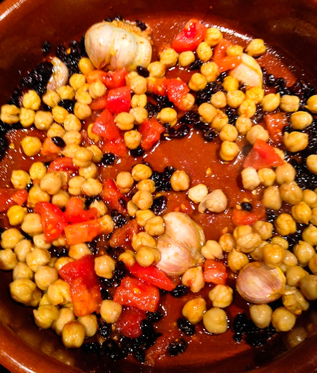 add chickpeas and tomatoes