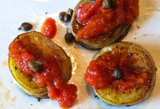 eggplant tomato capers closeup
